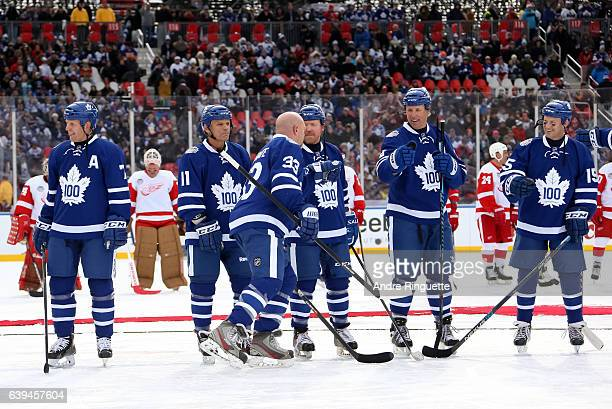 Toronto Maple Leafs alumni Al Iafrate high fives his teammates during the 2017 Rogers NHL Centennial Classic Alumni Game at Exhibition Stadium on...
