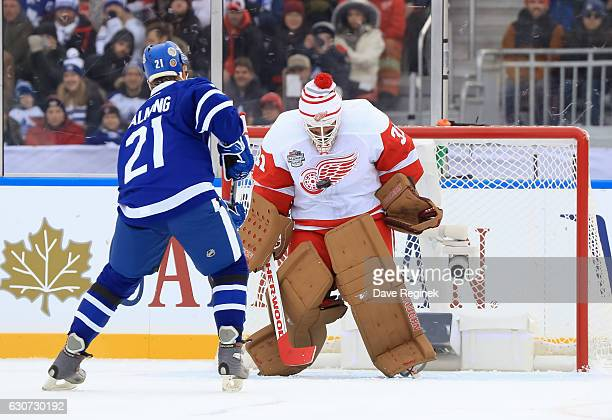 Toronto Maple Leafs alumni Borje Salming fires a penalty shot on Detroit Red Wings alumni Kevin Hodson during the 2017 Rogers NHL Centennial Classic...