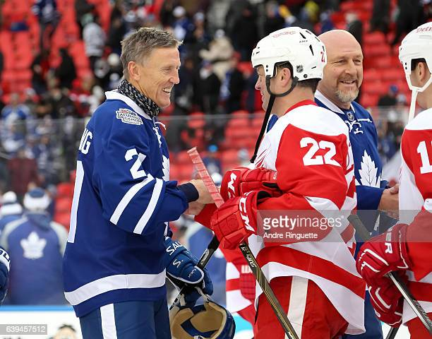 Toronto Maple Leafs alumni Borje Salming shakes hands with Detroit Red Wings alumni Dino Ciccarelli during the 2017 Rogers NHL Centennial Classic...
