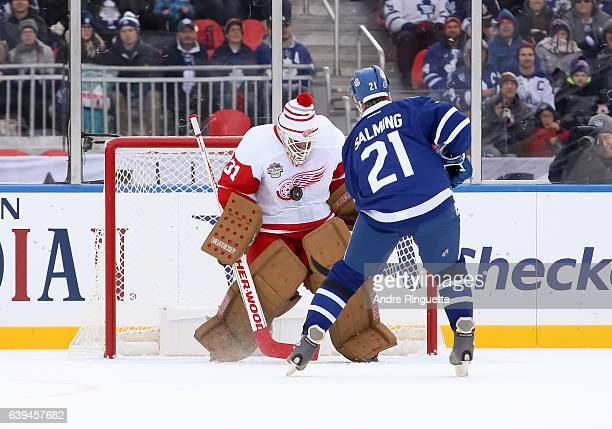 Toronto Maple Leafs alumni Borje Salming stickhandles the puck in on Detroit Red Wings alumni Kevin Hodson on a penalty shot during the 2017 Rogers...