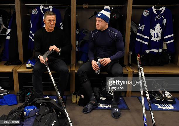 Toronto Maple Leafs alumni Borje Salming talks with Toronto Maple Leafs Morgan Rielly prior to the 2017 Rogers NHL Centennial Classic Alumni Game on...