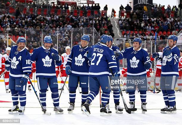 Toronto Maple Leafs alumni Darryl Sittler high fives his teammates during the 2017 Rogers NHL Centennial Classic Alumni Game at Exhibition Stadium on...