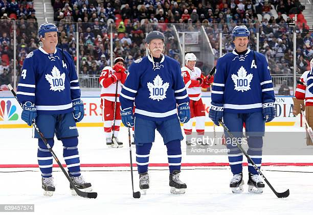 Toronto Maple Leafs alumni Dave Ellet Lanny McDonald and Gary Roberts line up before taking on Detroit Red Wings alumni during the 2017 Rogers NHL...