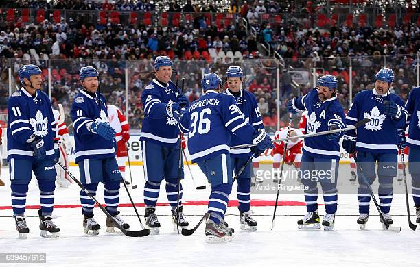 Toronto Maple Leafs alumni Dmitri Yushkevich high fives his teammates during the 2017 Rogers NHL Centennial Classic Alumni Game at Exhibition Stadium...