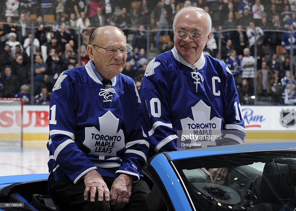 Toronto Maple Leafs Alumni Johnny Bower and George Armstrong take part in an ice ceremony honouring the 1963 Stanley Cup winning team prior to NHL game action between the Toronto Maple Leafs and the Ottawa Senators February 16, 2013 at the Air Canada Centre in Toronto, Ontario, Canada.