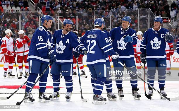 Toronto Maple Leafs alumni Steve Thomas high fives his teammates during the 2017 Rogers NHL Centennial Classic Alumni Game at Exhibition Stadium on...