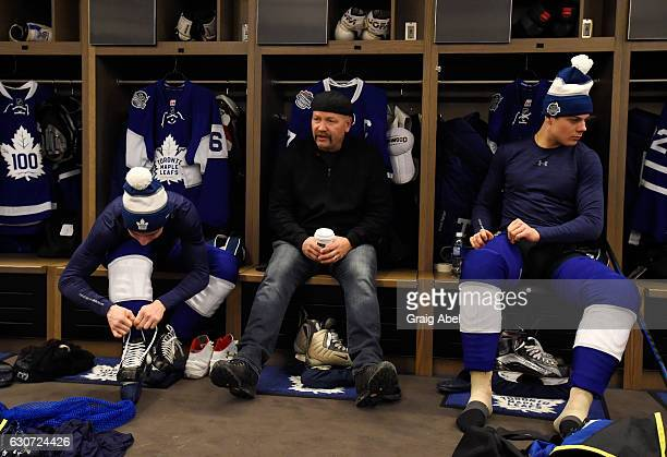 Toronto Maple Leafs alumni Wendel Clark sits between Toronto Maple Leafs Mitch Marner and Auston Matthews prior to the 2017 Rogers NHL Centennial...