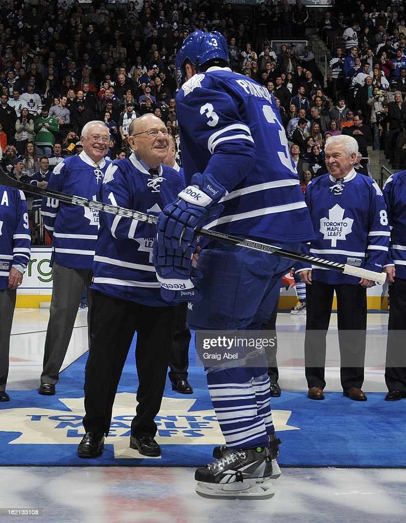 Toronto Maple Leafs Alumnus Johnny Bower shakes hands with Dion Phaneuf #3 of the Toronto Maple Leafs prior to NHL game action between the Toronto Maple Leafs and the Ottawa Senators February 16, 2013 at the Air Canada Centre in Toronto, Ontario, Canada.