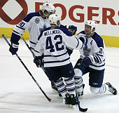 Toronto Maple Leafs Bryan McCabe is congratulated by teammates Nik Antropov and Kyle Wellwood after scoring a goal in action vs the Montreal...