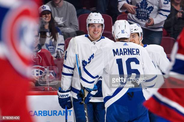 Toronto Maple Leafs center Auston Matthews celebrates with teammates after scoring his 2nd goal of the night during the third period of the NHL game...