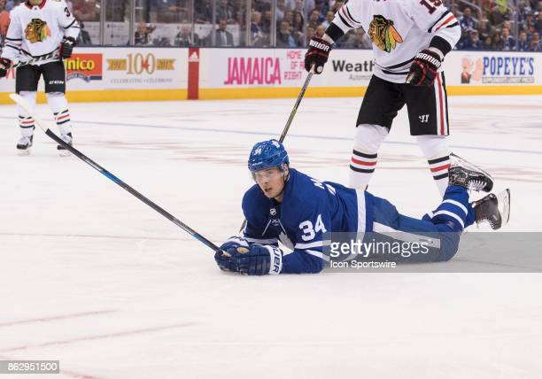 Toronto Maple Leafs center Auston Matthews is taken down to the ice in the second period during the Toronto Maple Leafs game versus the Chicago...