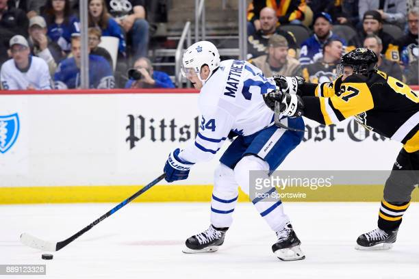 Toronto Maple Leafs Center Auston Matthews skates with the puck as Pittsburgh Penguins Center Sidney Crosby defends during the third period in the...