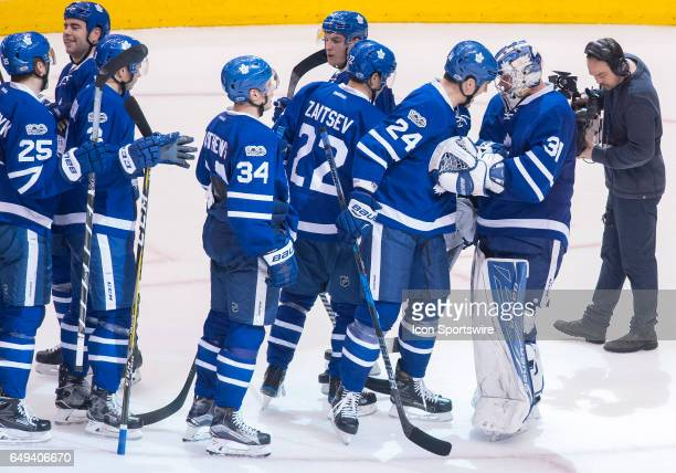 Toronto Maple Leafs center Brian Boyle celebrates the win with Toronto Maple Leafs goalie Frederik Andersen at the end of the third period in a game...
