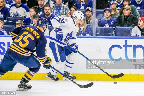 Toronto Maple Leafs Center Brian Boyle skates with the puck as Buffalo Sabres Defenseman Rasmus Ristolainen defends during the Toronto Maple Leafs...