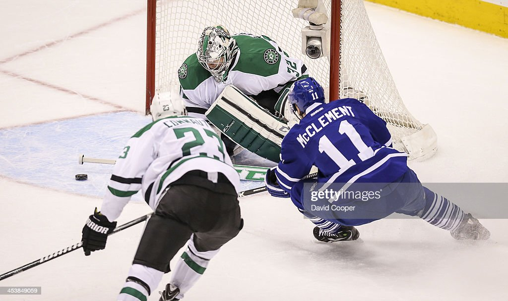 TORONTO ON DECEMBER 5 Toronto Maple Leafs center Jay McClement carves for the front of the net and goalie Kari Lehtonen followed by Dallas Stars...