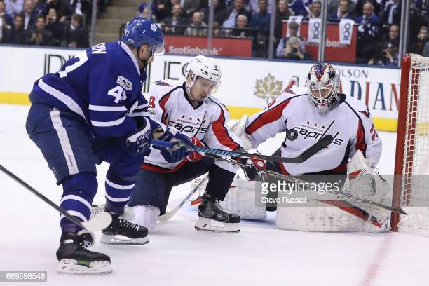 TORONTO ON APRIL 17 Toronto Maple Leafs center Leo Komarov chips a shot on Braden Holtby as the Toronto Maple Leafs play the Washington Capitals in...