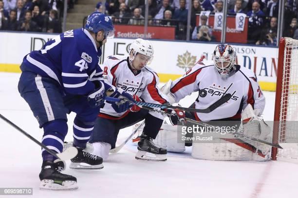 TORONTO ON APRIL 17 Toronto Maple Leafs center Leo Komarov chips a shot on Braden Holtby as the Toronto Maple Leafs play the Washington Capitals in...