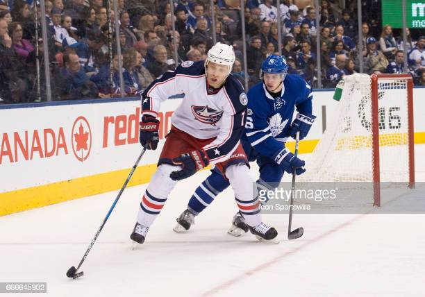 Toronto Maple Leafs center Mitchell Marner battles for a puck with Columbus Blue Jackets defenseman Jack Johnson during the second period in a game...