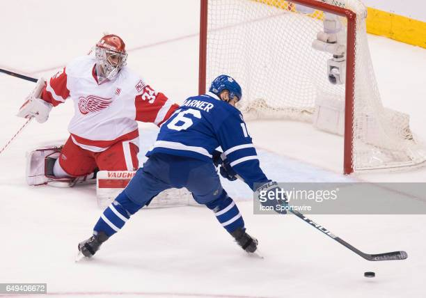 Toronto Maple Leafs center Mitchell Marner battles for a rebound in front of Detroit Red Wings goalie Petr Mrazek during the second period in a game...