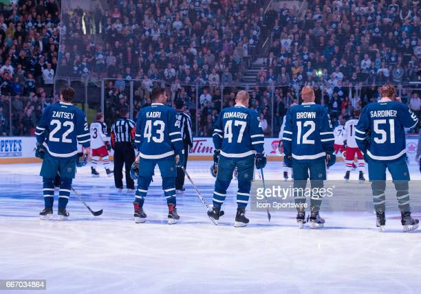 Toronto Maple Leafs center Nazem Kadri and Toronto Maple Leafs center Leo Komarov stand with the rest of the players during the national anthems...