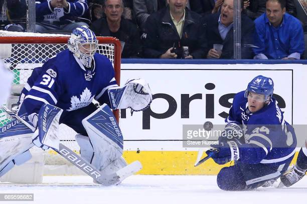TORONTO ON APRIL 17 Toronto Maple Leafs center Nazem Kadri clears a loose puck in front of Frederik Andersen as the Toronto Maple Leafs play the...