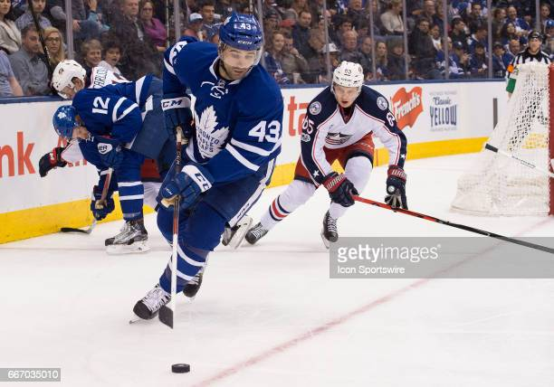 Toronto Maple Leafs center Nazem Kadri skates with the puck as Columbus Blue Jackets defenseman Markus Nutivaara gives chase during the second period...