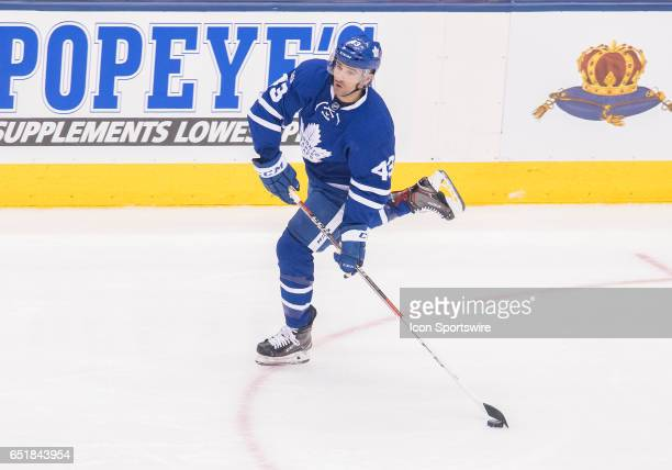 Toronto Maple Leafs center Nazem Kadri skates with the puck during the first period in a game against the Detroit Red Wings at Air Canada Centre in...