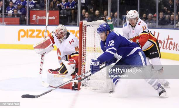 TORONTO ON DECEMBER 6 Toronto Maple Leafs center Patrick Marleau tries a wrap around on Calgary Flames goalie Mike Smith as the Toronto Maple Leafs...
