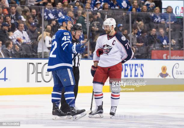Toronto Maple Leafs center Tyler Bozak and Columbus Blue Jackets left wing Nick Foligno talk with NHL referee Kelly Sutherland during the second...