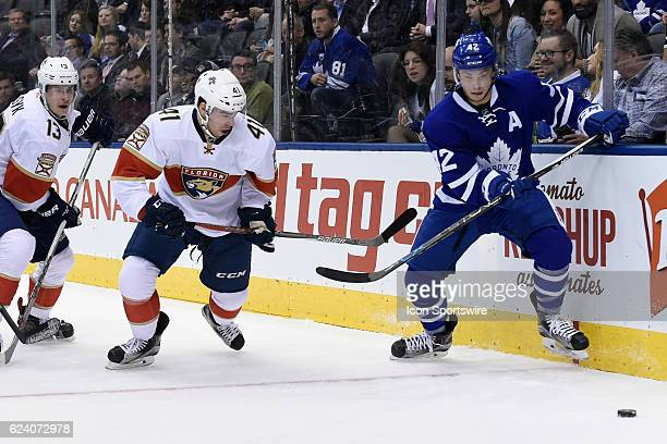 Toronto Maple Leafs Center Tyler Bozak and Florida Panthers Left Wing Greg McKegg fight for the puck during the NHL regular season game between the...