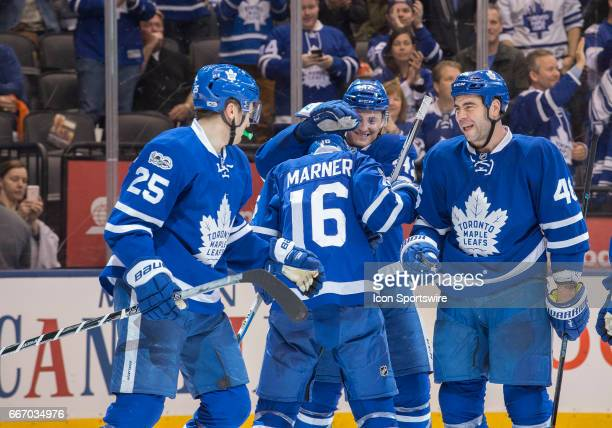 Toronto Maple Leafs center Tyler Bozak and Toronto Maple Leafs center Mitchell Marner celebrate a goal by Toronto Maple Leafs left wing James van...