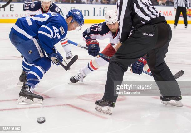 Toronto Maple Leafs center Tyler Bozak faces off with Columbus Blue Jackets center Brandon Dubinsky during the third period in a game on April 9 at...