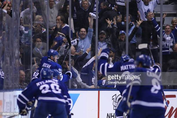 TORONTO ON APRIL 17 Toronto Maple Leafs center Tyler Bozak leaps into a teammates arms after scoring the winner as the Toronto Maple Leafs beat the...