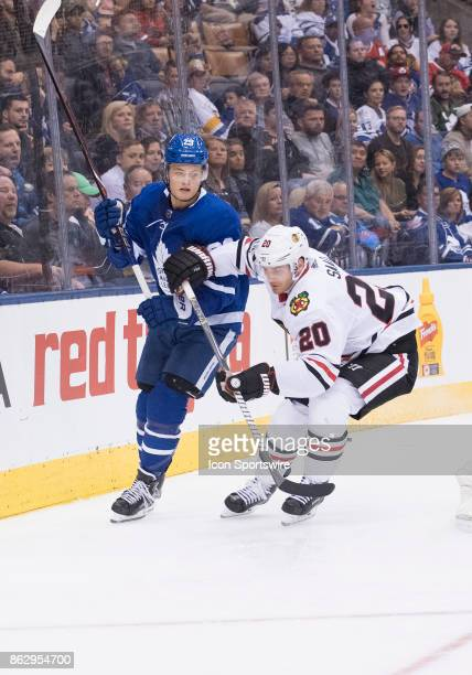 Toronto Maple Leafs center William Nylander battles along the boards with Chicago Blackhawks left wing Brandon Saad n the third period during the...