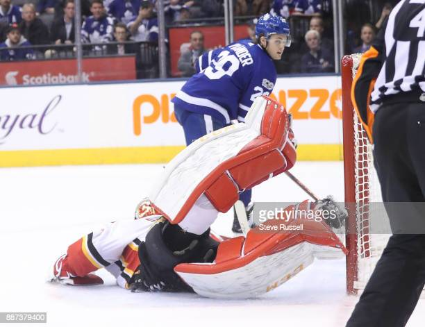 TORONTO ON DECEMBER 6 Toronto Maple Leafs center William Nylander beats Calgary Flames goalie Mike Smith in the shootout as the Toronto Maple Leafs...