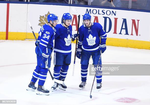 Toronto Maple Leafs center William Nylander celebrates scoring a goal with Toronto Maple Leafs center Auston Matthews and Toronto Maple Leafs center...