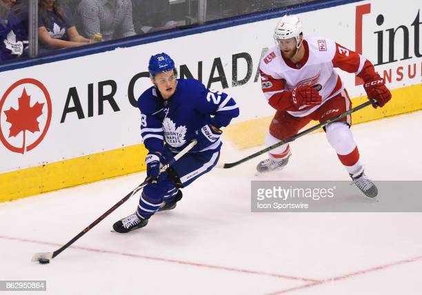 Toronto Maple Leafs center William Nylander controls a puck as Detroit Red Wings defenseman Nick Jensen gives chase in the third period during the...