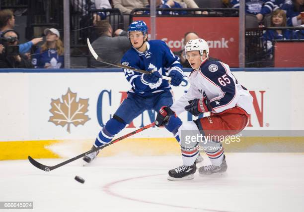 Toronto Maple Leafs center William Nylander shoots a puck past Columbus Blue Jackets defenseman Markus Nutivaara during the second period in a game...
