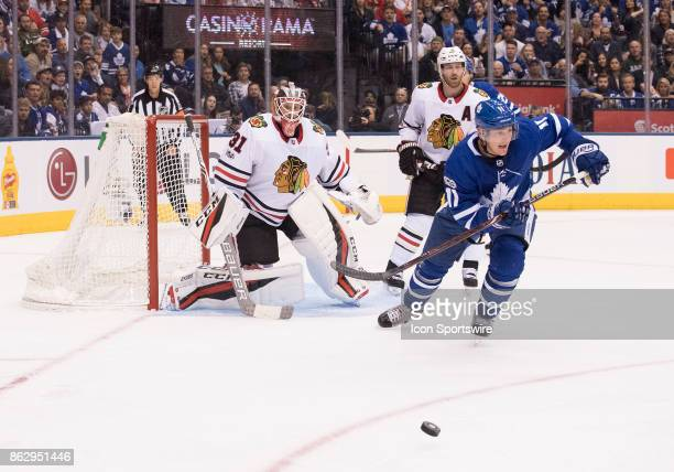 Toronto Maple Leafs center Zach Hyman chases down a puck in front of Chicago Blackhawks goalie Anton Forsberg in the second period during the Toronto...
