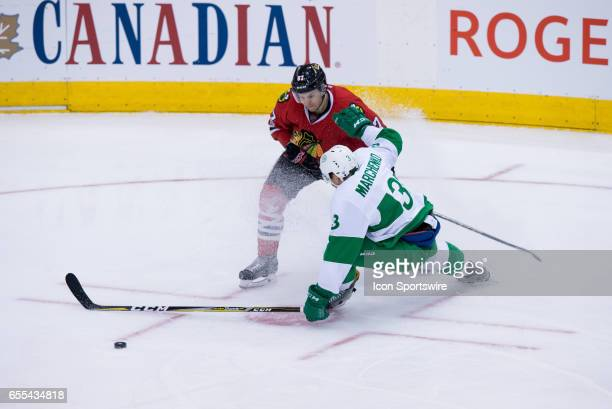 Toronto Maple Leafs Defenceman Alexey Marchenko battles for the puck against Chicago Blackhawks Center Tanner Kero during the second period of the...