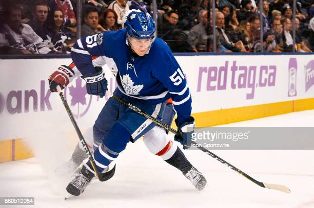 Toronto Maple Leafs Defenceman Jake Gardiner is chased behind the net during the NHL regular season hockey game between the Washington Capitals and...