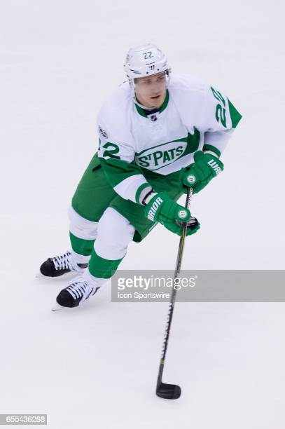 Toronto Maple Leafs Defenceman Nikita Zaitsev skates with the puck during the NHL regular season game between the Toronto Maple Leafs and the Chicago...