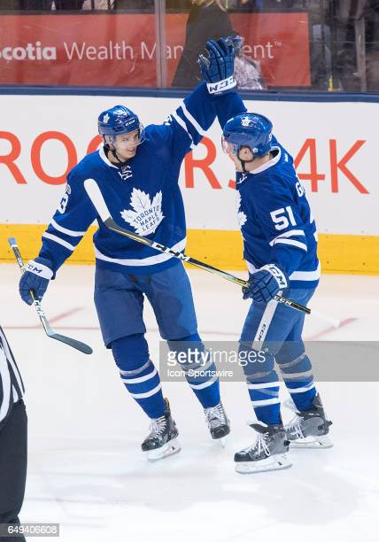 Toronto Maple Leafs defenseman Alexey Marchenko celebrates scoring his first goal as a Toronto Maple Leaf with Toronto Maple Leafs defenseman Jake...