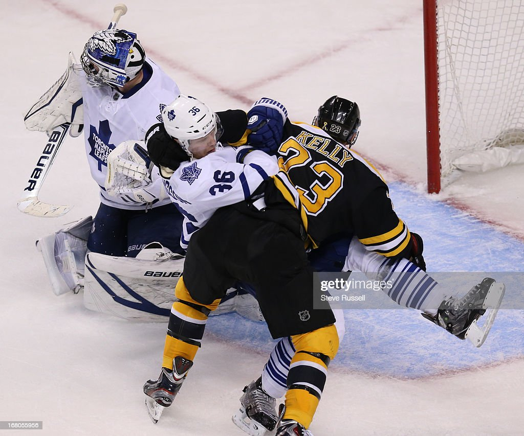 BOSTON MA MAY 4 Toronto Maple Leafs defenseman Carl Gunnarsson gets slammed to the ice by Boston Bruins center Chris Kelly as the Toronto Maple Leafs...
