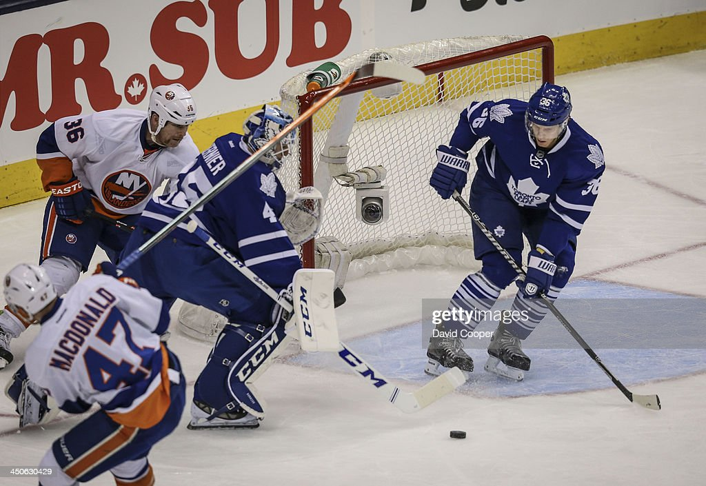 TORONTO ON NOVEMBER 19 Toronto Maple Leafs defenseman Carl Gunnarsson plays goalie while Toronto Maple Leafs goalie Jonathan Bernier is caught out of...