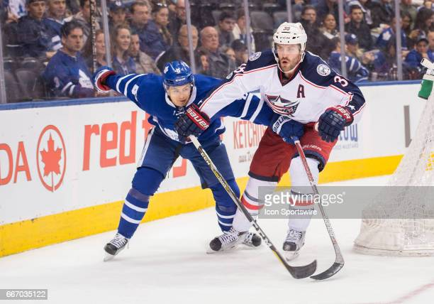 Toronto Maple Leafs defenseman Connor Carrick battles with Columbus Blue Jackets center Boone Jenner during the third period in a game on April 9 at...