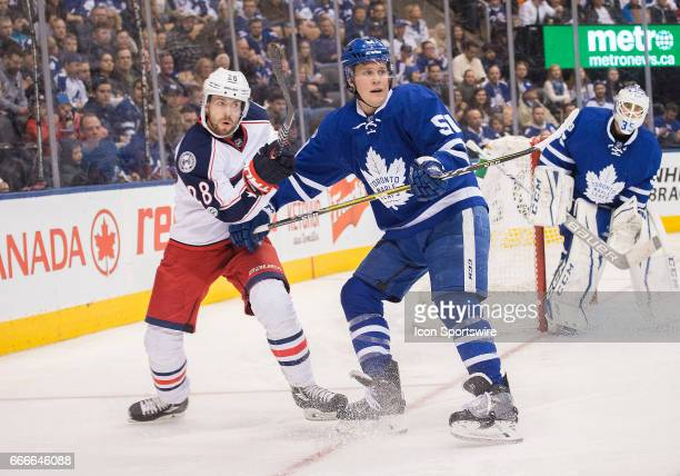 Toronto Maple Leafs defenseman Jake Gardiner battles with Columbus Blue Jackets right wing Oliver Bjorkstrand during the third period in a game on...