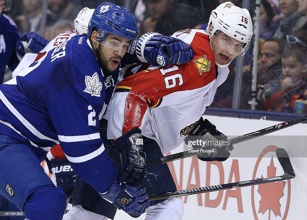 TORONTO, ON- DECEMBER 17 - Toronto Maple Leafs defenseman <a gi-track='captionPersonalityLinkClicked' href=/galleries/search?phrase=Mark+Fraser+-+Ice+Hockey+Player&family=editorial&specificpeople=5513661 ng-click='$event.stopPropagation()'>Mark Fraser</a> ties up Aleksander Barkov in second period action as the Toronto Maple Leafs play the Florida Panthers at Air Canada Centre in Toronto. December 17, 2013.
