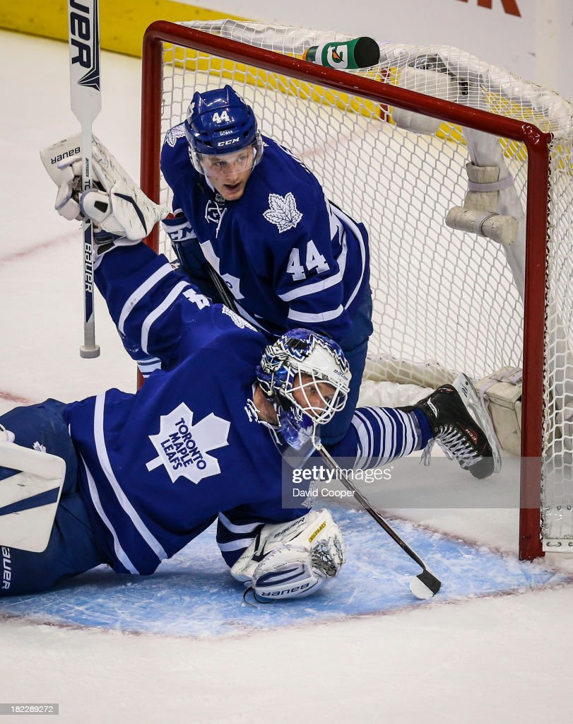 TORONTO, ON- SEPTEMBER 28 - Toronto Maple Leafs defenseman Morgan Rielly (44) in behind Toronto Maple Leafs goalie James Reimer (34) during the game as the Toronto Maple Leafs defeated the Detroit Red Wings 3-1 at the Air Canada Centre in Toronto, September 28, 2013.