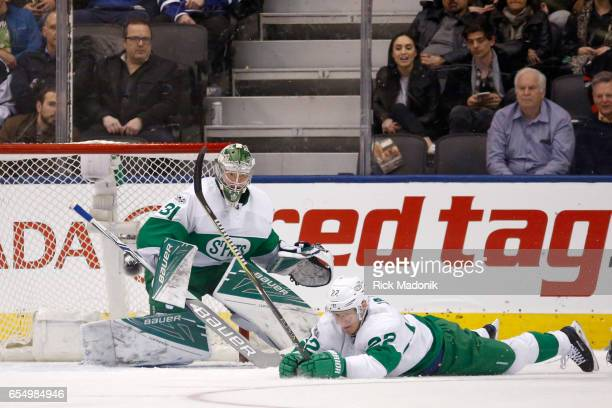 Toronto Maple Leafs defenseman Nikita Zaitsev covers up the puck in front of Toronto Maple Leafs goalie Frederik Andersen Toronto Maple Leafs VS...